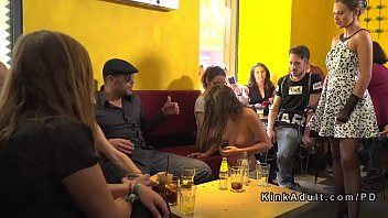 Brunette sub serving crowd in public bar 5 min