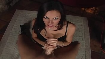 A beautiful brunette lady who likes to play with her hands and her mouth