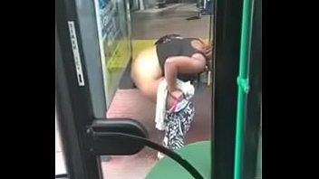 Ebony fatty squirts at bus-stop !