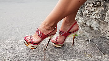 Sexy feet in sandals - Sexy lady with awesome feet with high heels red sandals