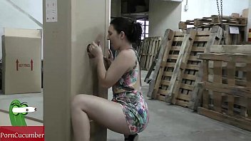 She eats cock through a hole in a box to fill with milk tits