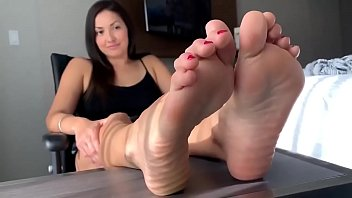 Beautiful woman shows the soles of her feet