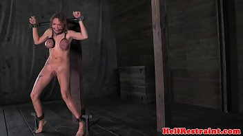 Restrained milf surrenders to her master