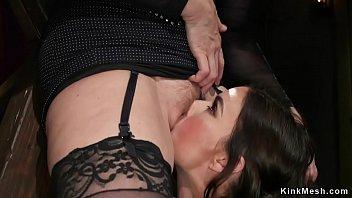 Busty Milf spanks brunette lesbian