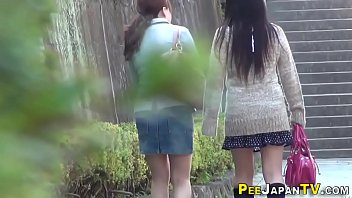 Asian babe pisses herself