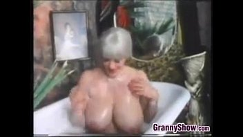 Latex movie sample - Busty grandma in the bath tub classic