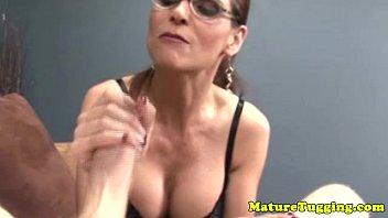 Handjob loving spex mature tugs cock
