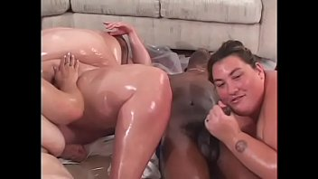 Four oiled chubbettes press one thin black guy