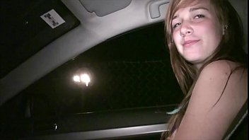 Young hot teen girl Alexis Crystal undressing in a car on the way to public orgy porn image