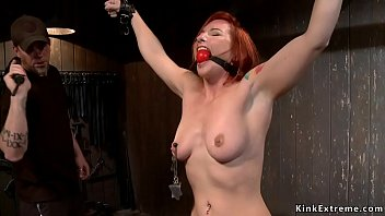 Tough redhead slave tormented in device