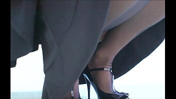 Kneeling in her stockings