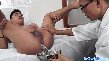 Gay asian doc drains enema milk before anal