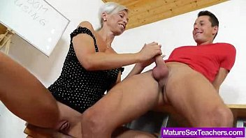 Blond-haired Madam giving a blowjob
