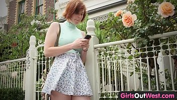 Girls Out West - Busty ginger lesbians lick hairy cunts outside