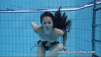 Nude beach sports - Cute umora is swimming nude in the pool