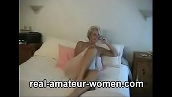 Lovely 60 plus blonde lady posing (three parts) thumbnail