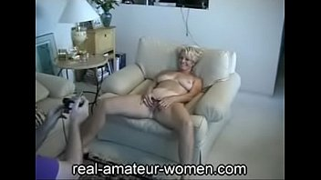 Lovely 60 plus blonde lady posing (three parts) image