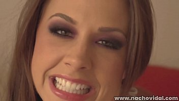 Chanel Preston wears a form-fitting dress made of white fishnet. After  she has completely submitted to Nacho's cock, he ejaculates right on Chanel's pretty face.