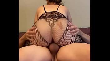 Hotwife in bodystocking rides hard cock