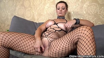 Euro milf Mia gets naughty in leather dress and boots
