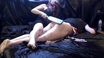Slave spank spanker Over sissys knees on the bed