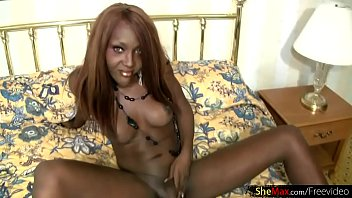 Ebony chick with dick is stripping and fingering shaved ass