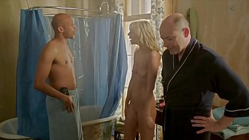 Totally nude girl surprised in the shower.  Full frontal, shaved pussy in the 2013 movie Hell Baby featuring Riki Lindhome