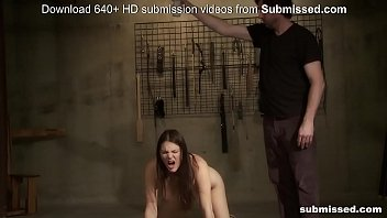 Beautiful brunette slave is submissed with spanks,spikes and hot wax