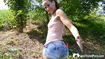 Beautiful stepdaughter masturbates with a toy outdoors