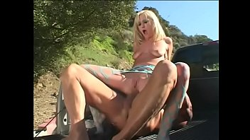 Horny ball-breaker is doing a back scuttle with pretty blonde hottie Hillary Scott at the pick up trunk
