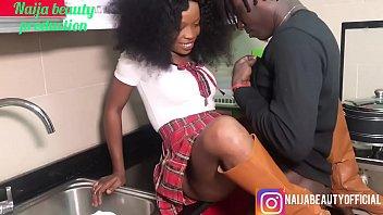 Naija beauty fucks her brothers friend in the kitchen