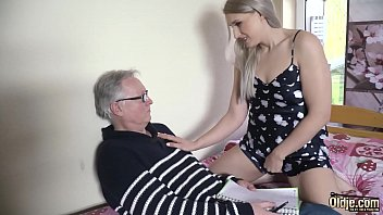 Diane on her knees sucking on his nice cock