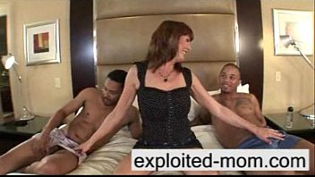 Busty milf takes 2 big black cocks at once in Interracial Threesome Video