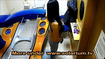 TaliaViolet  Horny girl with really big tits masturbates and fingers herself in the public solarium