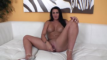 Horny brunette  chick Corina Jayden bends over and fingers her pussy from the back