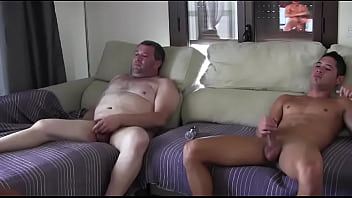 Father and son fuck inside the living room for an exciting encounter