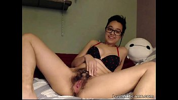 Brunette plays with her hairy pussy on cam