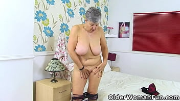 British granny Savana is showing off in fishnet tights