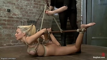 Hogtied busty blonde dyke flogged