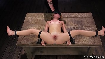 Blonde In Stock And Metal Bondage Toyed