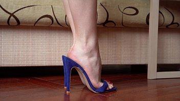 Feet In High Heels Closeup, Dangling And Dipping thumbnail