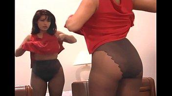 Busty brunette fingering her pussy in pantyhose