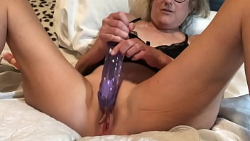 60 year old milf wife spreads her shaved pussy and masturbates with a 9 inch dildo 10 min