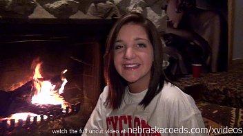 sexy teen uding glass dildo next to parents fireplace