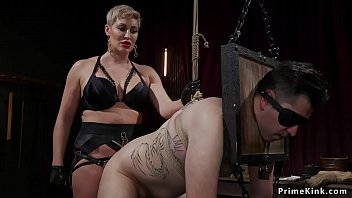 Busty blonde domina pegging bound man