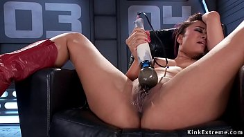 Asian squirter in boots fucking machine