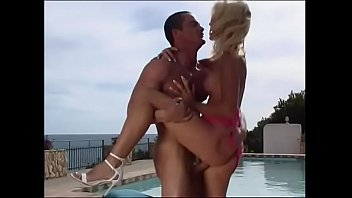 Sexy blonde lady with nice boobs Nicoletta Blue gets her pussy beat by ther pool