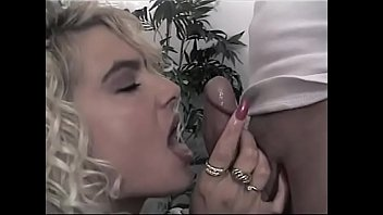 Curly haired MILF bitch fills her mouth with nice fat cock