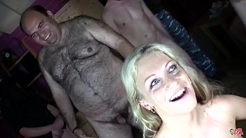 Sweet Jane's first Bukkake, the blue-eyed blonde bathes in cum