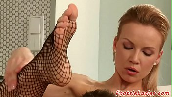 Pussyfucked babe footworshiped in fishnets